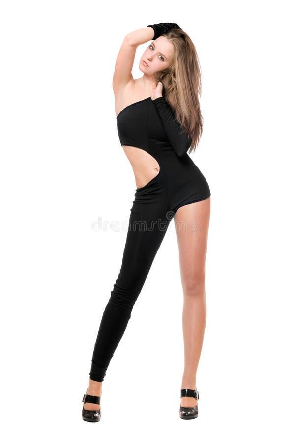 Leggy молодая женщина в skintight черном костюме стоковое фото