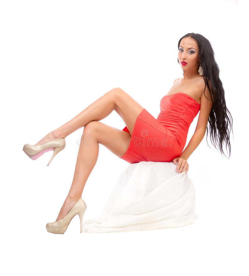 Download Leggy Brunette In A Red Dress Stock Photo - Image: 25570210