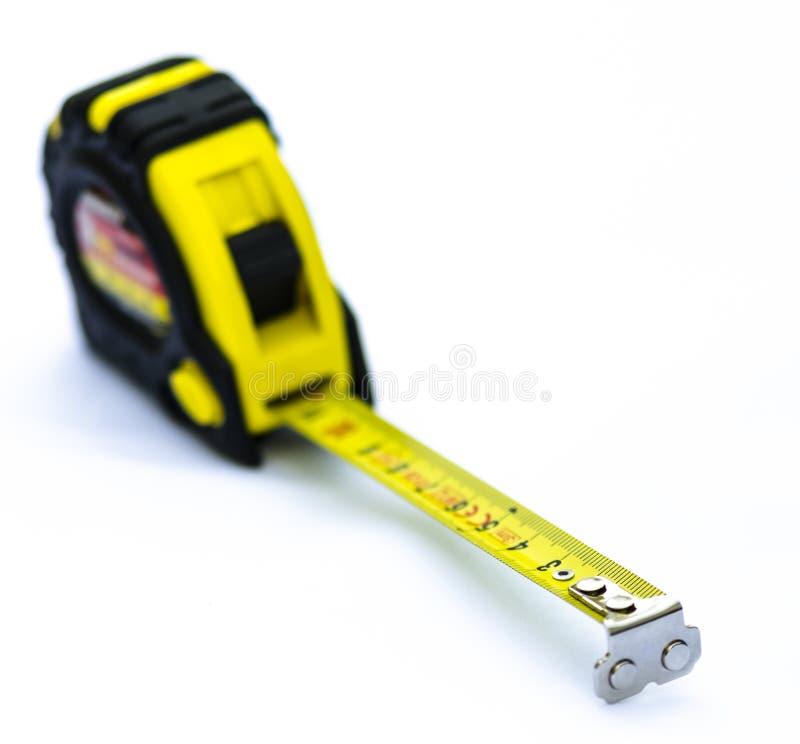 Leghi lo strumento di misura con un nastro fotografia stock libera da diritti