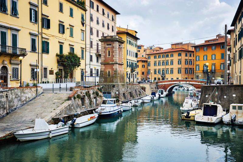 LEGHORN, ITALY - OCTOBER 3, 2017: Boats moored on canal in Venezia Nuova district of Livorno, Tuscany. Travel scenic cityscape. Postcard royalty free stock photos