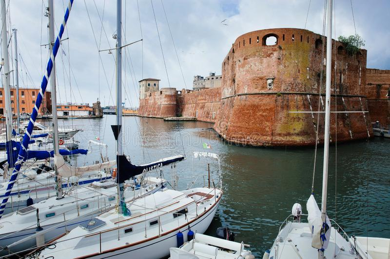 LEGHORN, ITALY - OCTOBER 3, 2017: Fortezza Vecchia and moored yachts in Livorno, Tuscany. One of biggest port cities. Travel. Scenic cityscape postcard royalty free stock photos