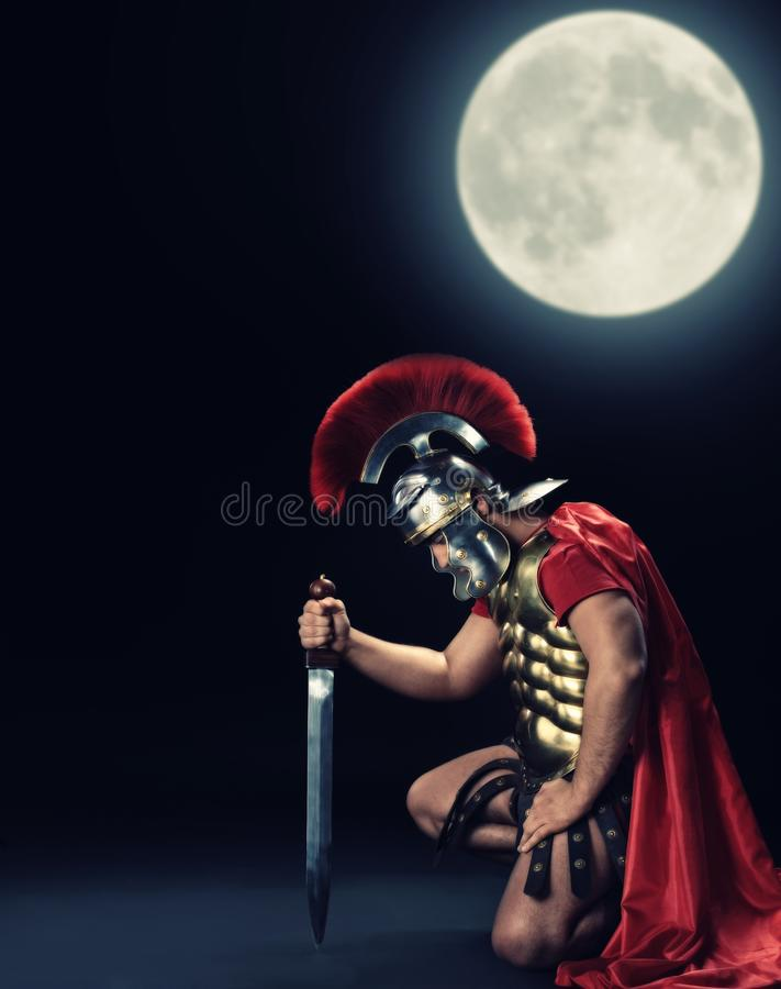 Legionary soldier standing on a knee stock photos