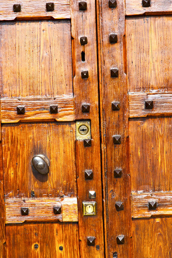 In legnano rusty brass brown knocker a door. Curch closed metal italy lombardy stock images
