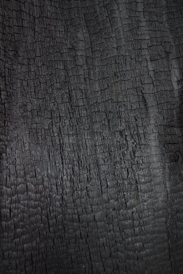 Legno bruciato come fondo fotografia stock