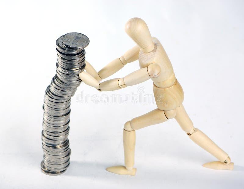 Legno e monete fotografia stock libera da diritti