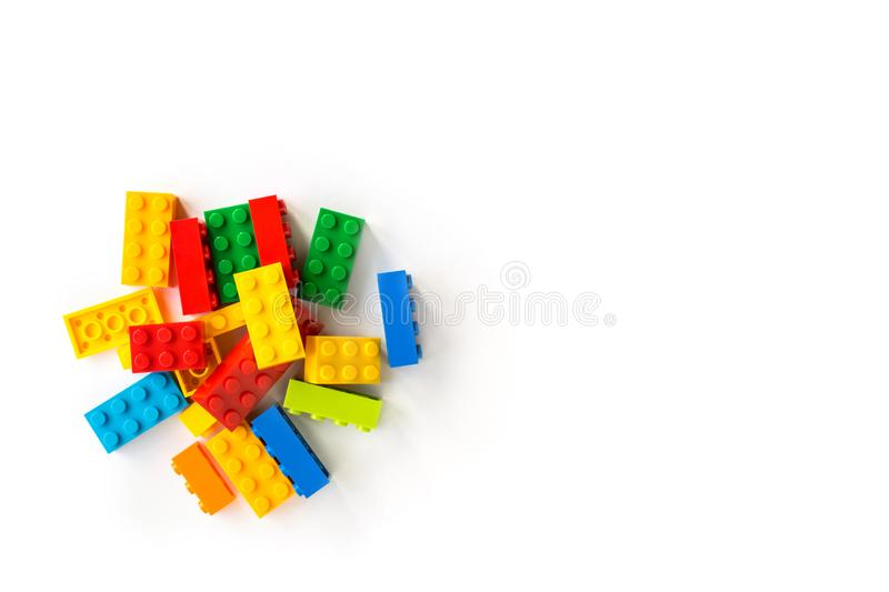 Lego background. Bunch of Colorful Plastick constructor cubes on white background. Popular toys. Copyspace. Lego background. A bunch of Multicolor Plastick royalty free stock photo