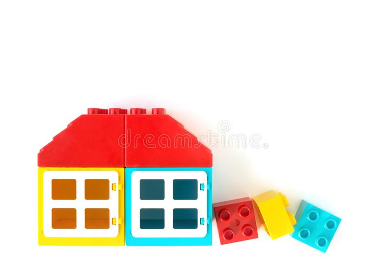Lego background. House made of Small and big plastic constructor bricks on white background. Popular toys. Lego background. Colorful House made of Small and big royalty free stock images