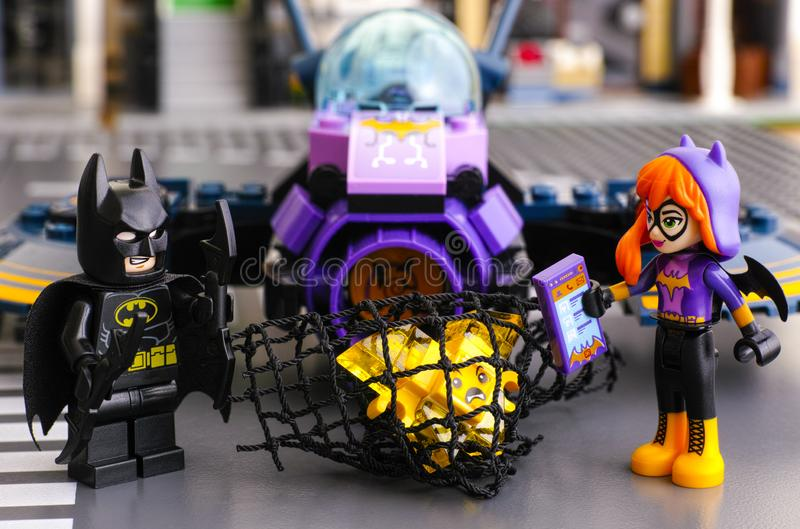 Lego Batman and Batgirl caught in net yellow Kryptomite royalty free stock photography