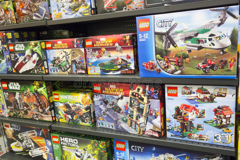 Lego boxes on shelves. Paphos, Cyprus - December 08, 2013: Lego boxes on shelves in supermarket. Here are the famous Lego series - Lego Super heroes, Lego Star stock image