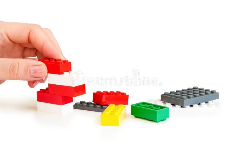 Lego bricks with hand. On a white background stock photography