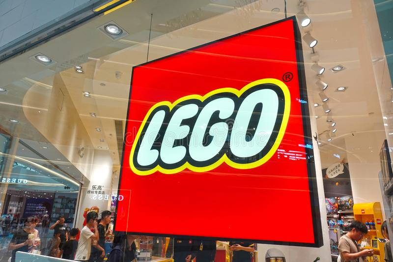 Lego logo toy retail shop window front. Lego building blocks are childrenundefineds favorite toys. Lego was founded in Denmark, and the trademark `LEGO` has been stock photos