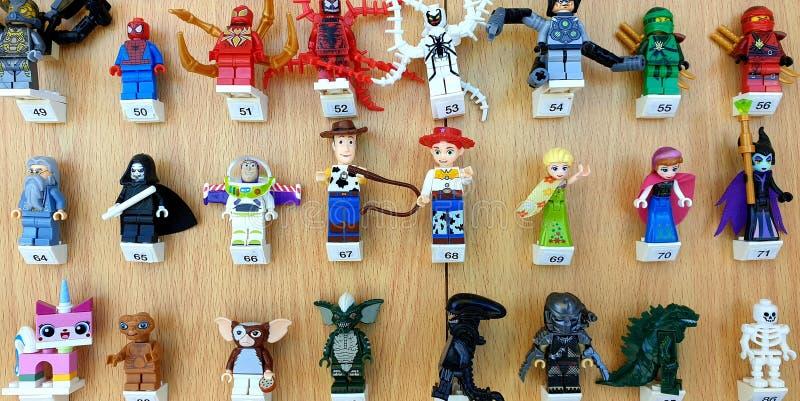 Lego movie  characters figures. Many Lego movie characters figures on a wooden background royalty free stock photo
