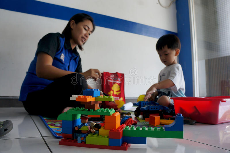 Lego. A child learns to assemble Lego in a course place in Sukoharjo, Central Java, Indonesia stock photo