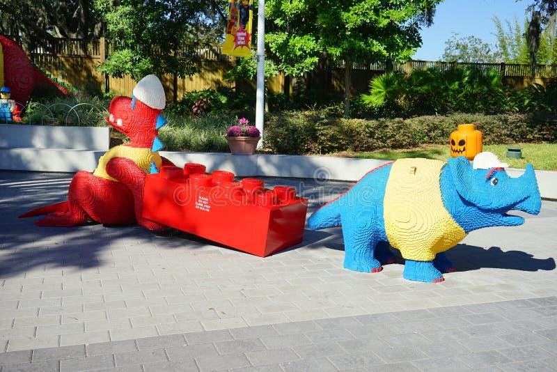 Lego Dinosaur and rino at Legoland florida. A red Lego Dinosaur and a blue rino taken in in legoland florida, USA stock photo