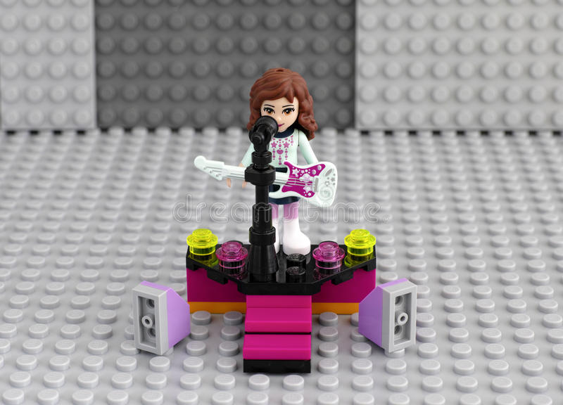 Lego friends girl with electric guitar on the stage stock photo