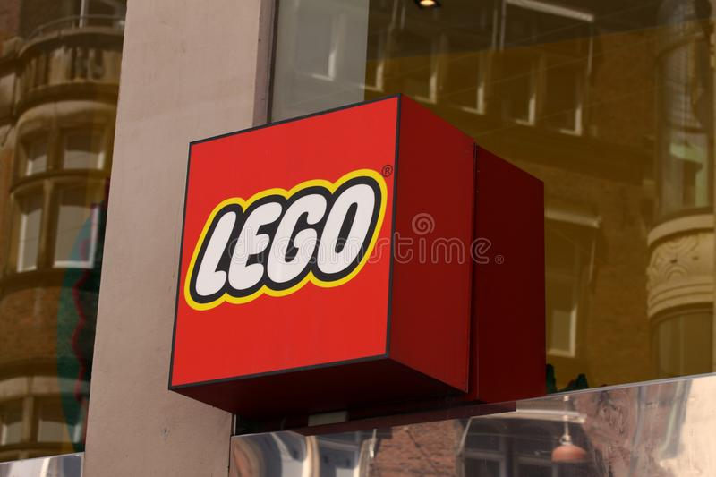 Lego logotype sign on shop. Lego is a line of plastic construction toys manufactured by The Lego Group, a company based in Denmark royalty free stock image