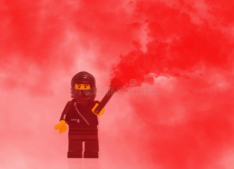 Lego Mini Figure Character In Red Smoke Free Public Domain Cc0 Image