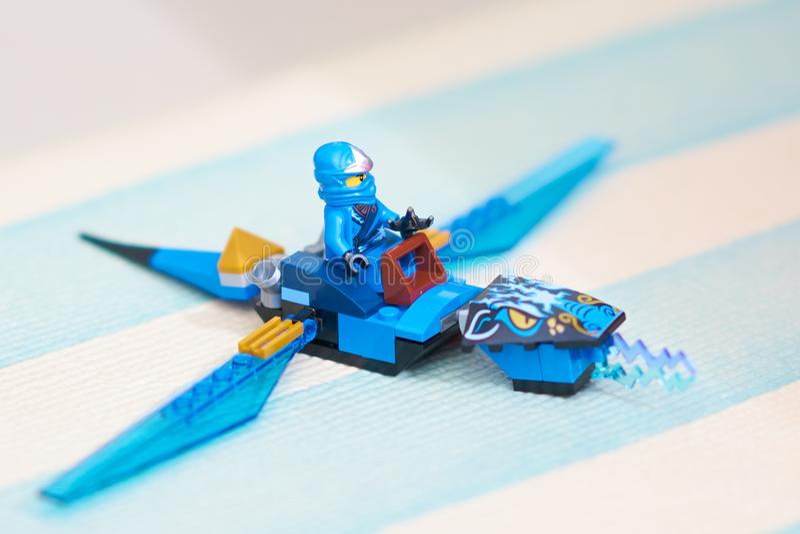 Lego,ninjago on flying dragon aerocraft royalty free stock images