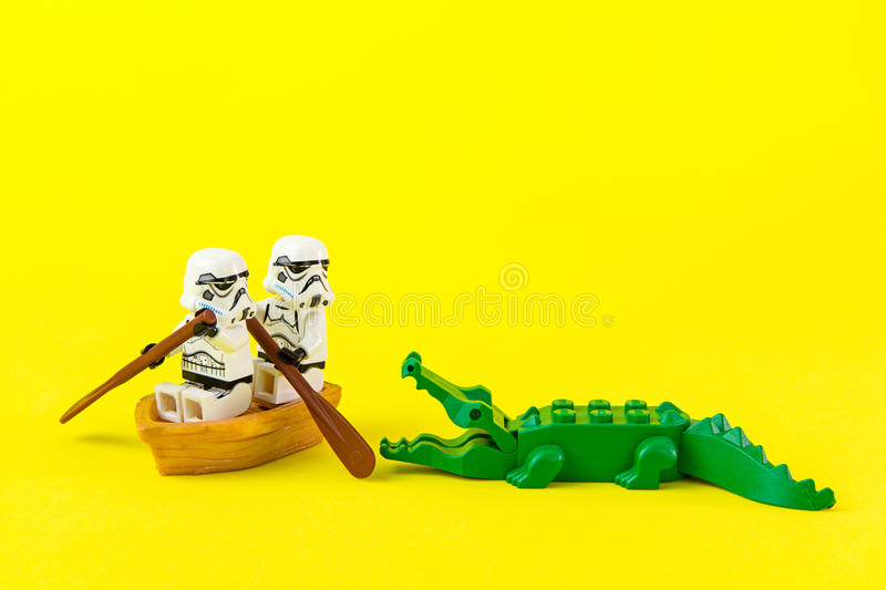 Lego star wars ferried escaped crocodile bite. Nonthabure, Thailand - July, 07, 2016: Lego star wars ferried escaped crocodile bite.The lego Star Wars mini stock image