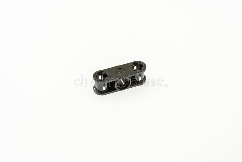 Lego technic piece. Special lego technic piece on a white background royalty free stock image