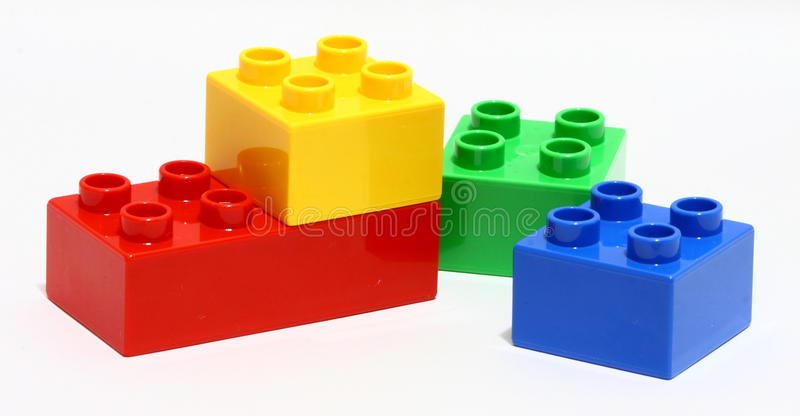 Lego time. Lego building bricks in different colors over white background