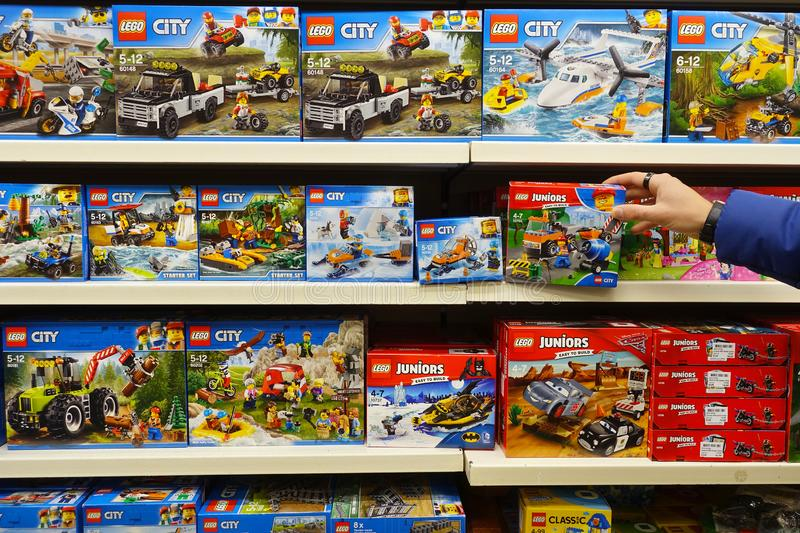 Lego toys in a store. MEPPEN, GERMANY - OCTOBER 2018: Shelves shows assortment Lego City boxes in a Toy store. LEGO is a popular line of construction toys royalty free stock photos