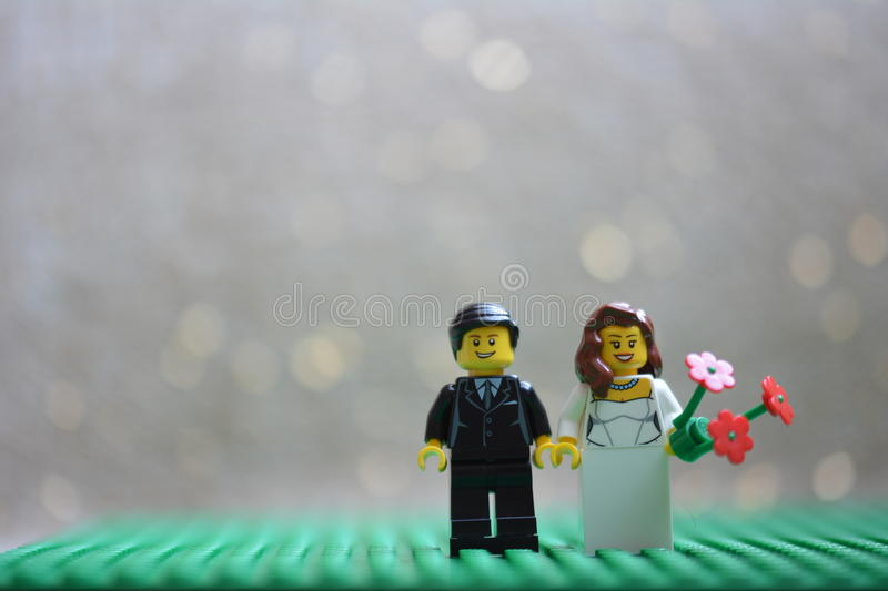 Lego wedding. Couple with flowers stock photo
