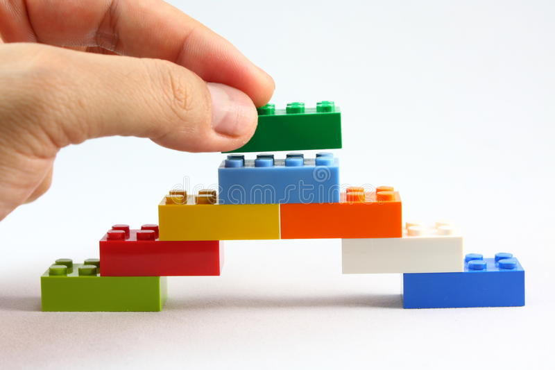 Lego. Young kids intellectual toys. Building and assembling with lego bricks royalty free stock photography