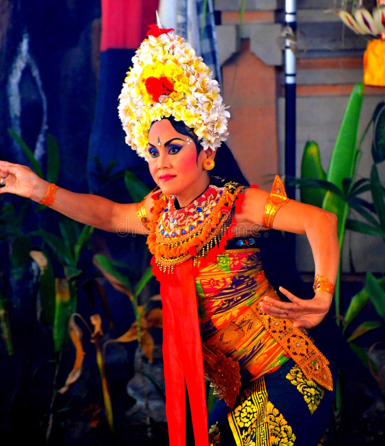 A Legong Dancer. Legong is a form of Balinese dance. It is a refined dance form characterized by intricate finger movements, complicated footwork, and expressive stock photo