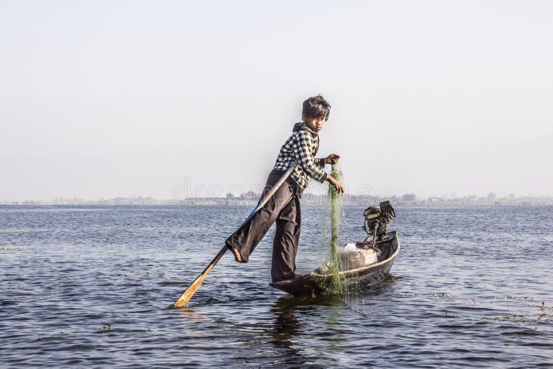 Legrowing fiskare royaltyfri bild