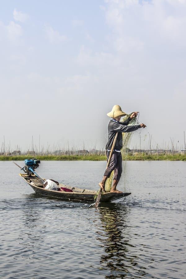 Legrowing fiskare royaltyfria bilder
