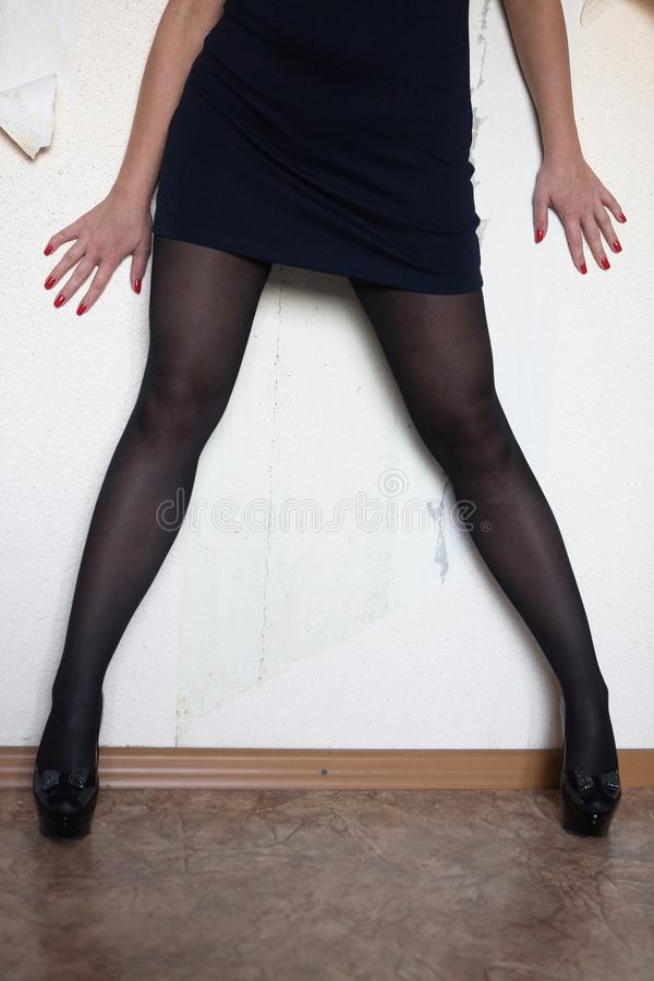 The legs and arms of a slim woman. stock image