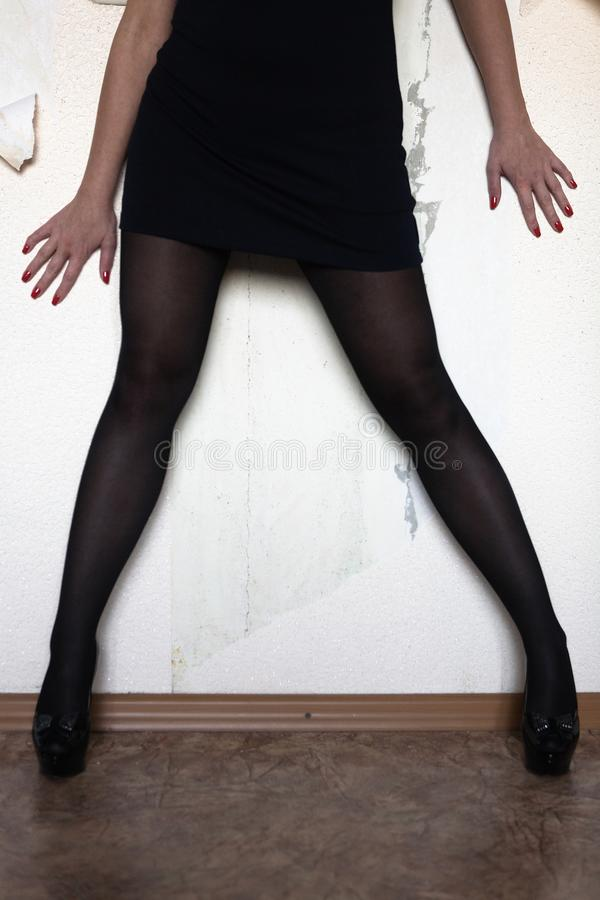 The legs and arms of a slim woman. stock photos