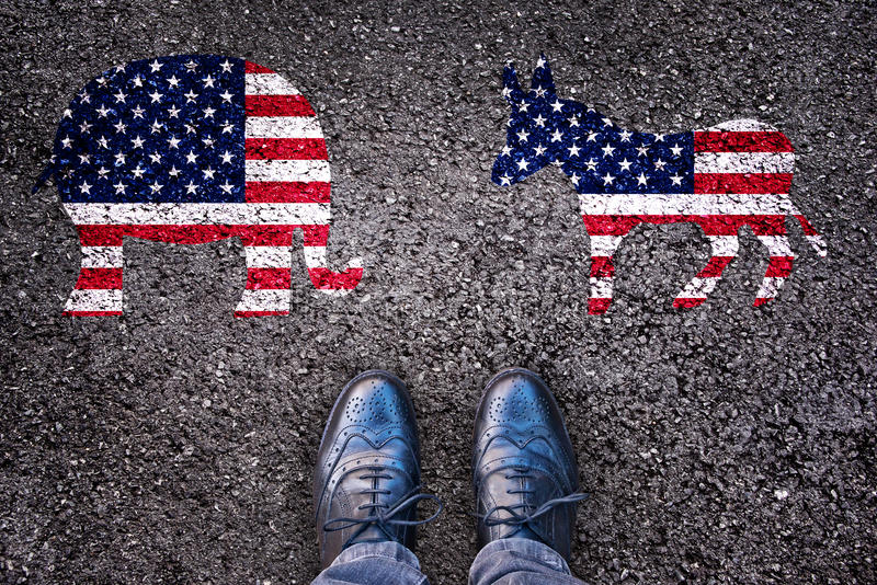 Legs on asphalt road with elephant and donkey, american election stock image