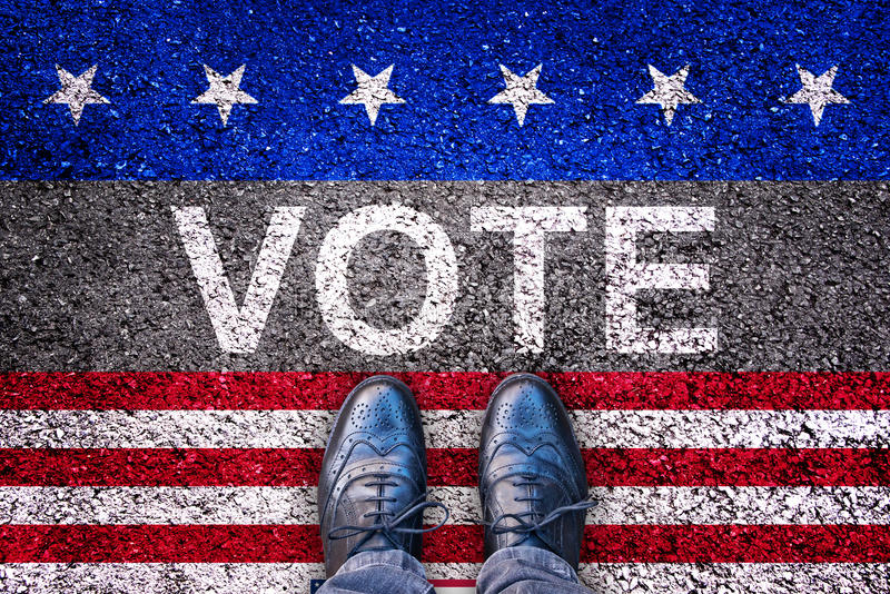 Legs on asphalt road with the word vote, USA election concept stock images