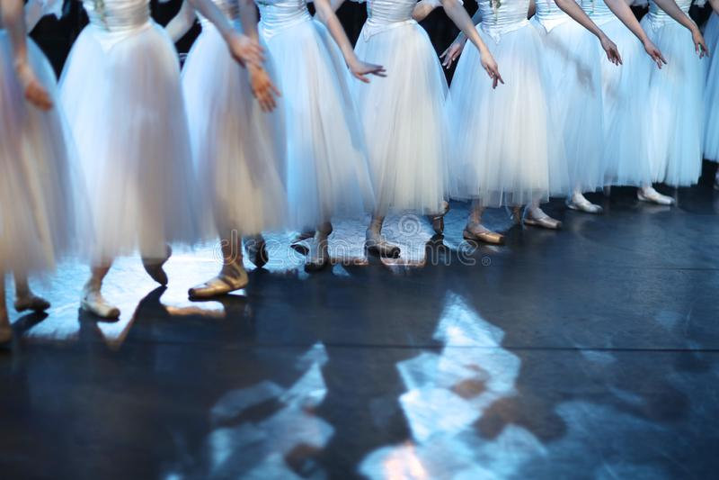 Legs of ballet dancers corps de ballet in pointe shoes stock image