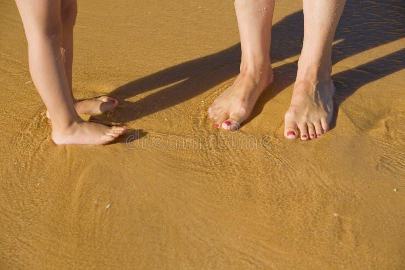Legs on the beach royalty free stock photos