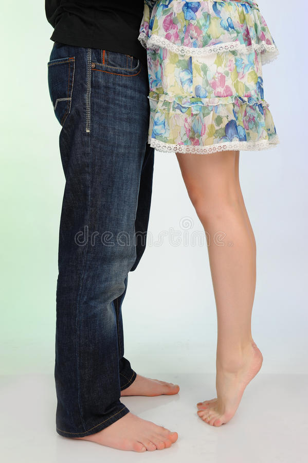 Legs of beautiful couple kissing. Studio shot royalty free stock photos