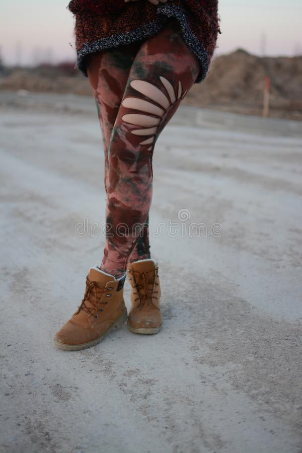 Legs in beautiful and unique cut out tights, festival fashion, golden hour, warm evening royalty free stock images