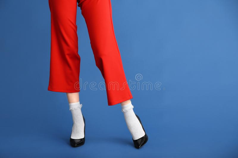 Legs of beautiful young woman on color background royalty free stock image