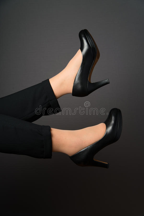 Legs and black shoes royalty free stock image