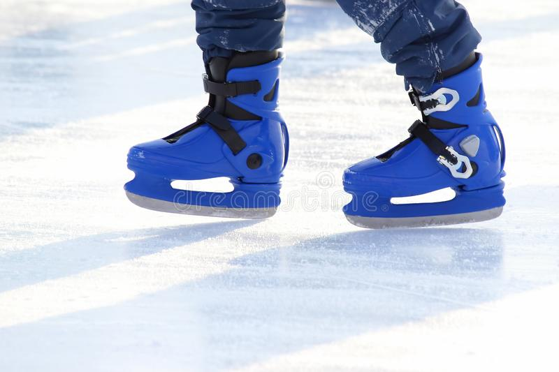 Legs in blue skating on the ice rink. The legs in blue skating on the ice rink royalty free stock photo