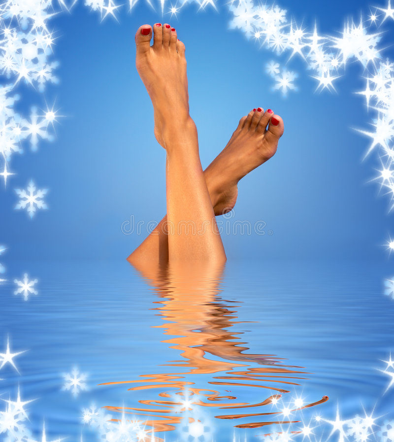 Legs In Blue Water Royalty Free Stock Photography