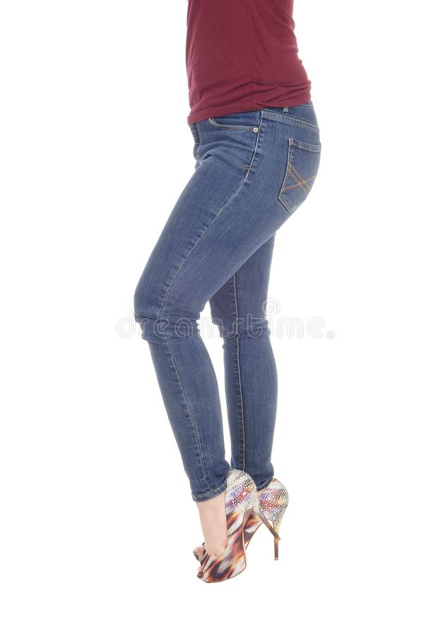 Legs and bottom of slim young woman royalty free stock images