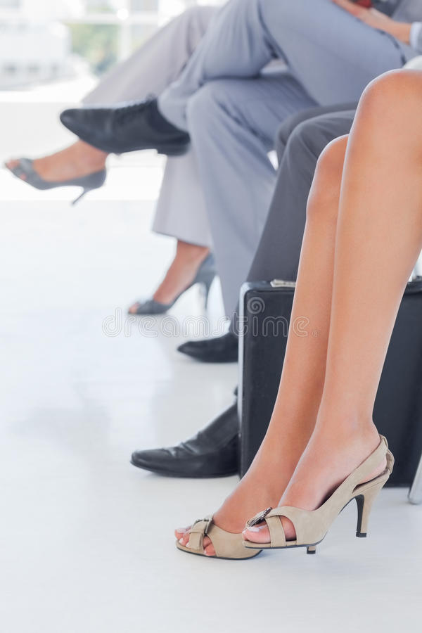 Legs of business people in line royalty free stock image