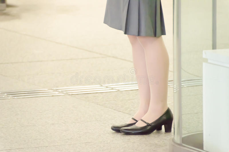 Legs of a business woman. This is a photo of legs of a business woman stock photos