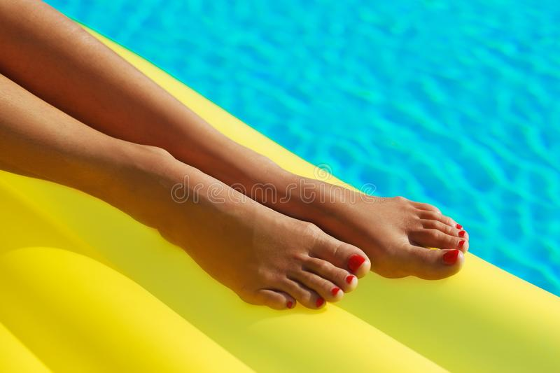 Legs close up. Creative gel polish red stock images