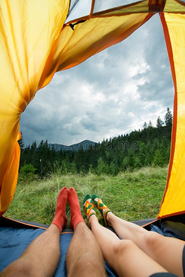 Legs of a couples of man and woman in a tent outdoors stock photos
