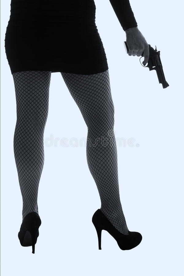 Download Legs Of Dangerous Woman With Handgun And Black Shoes Silhouette Stock Image - Image: 34453649