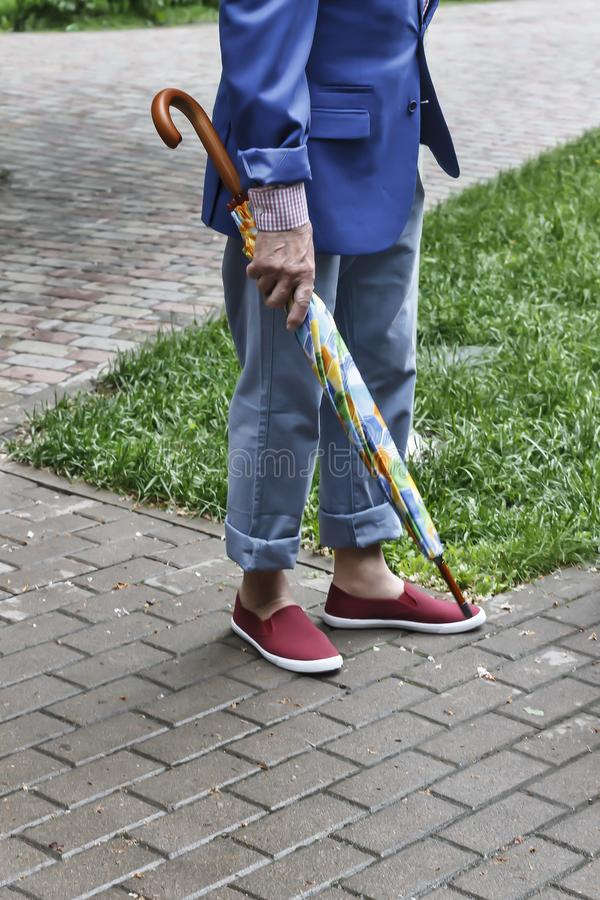 Legs of the elderly in fashionable clothes. royalty free stock images